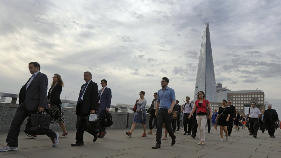 Commuters cross London Bridge