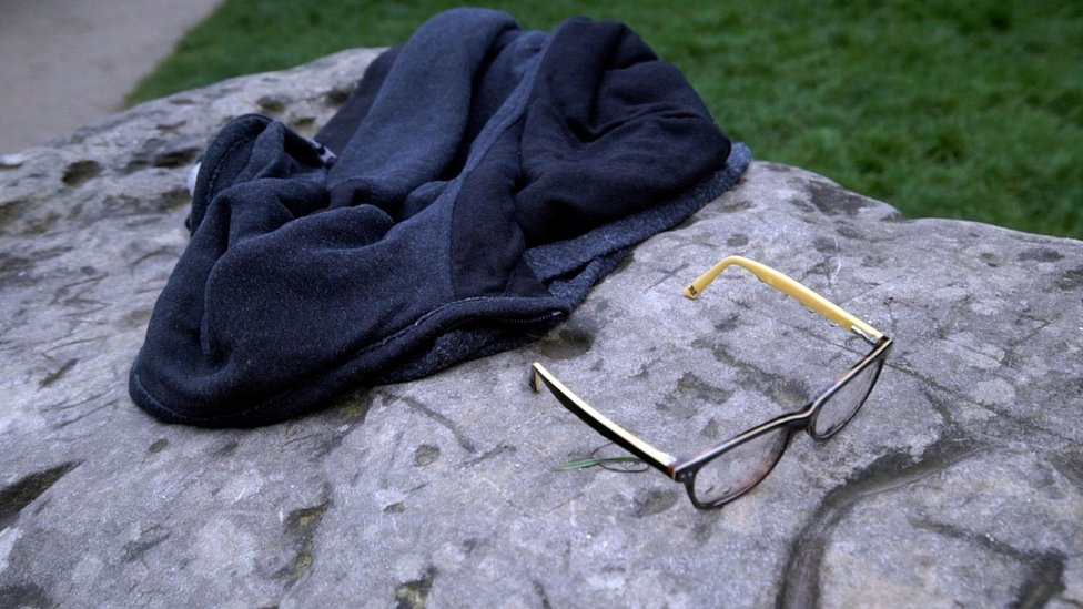 A child's glasses and a jacket lie on a rock in the Parc Monceau, after a lightning strike in Paris, May 28, 2016
