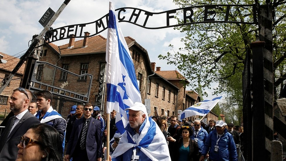 People commemorate the Holocaust at the former Nazi concentration camp Auschwitz, Poland, May 2, 2019
