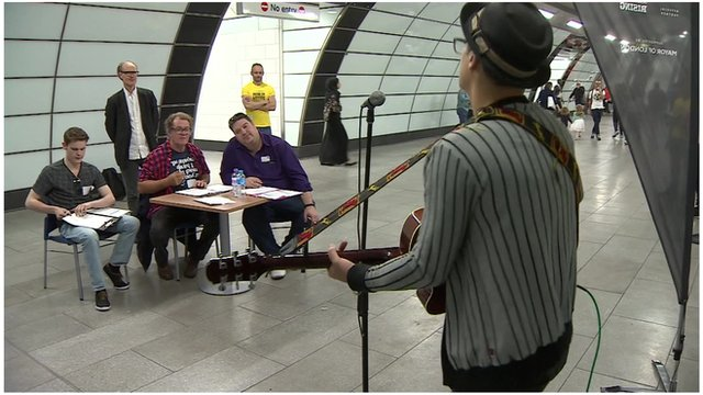 Judges watch busker audition at Tube station