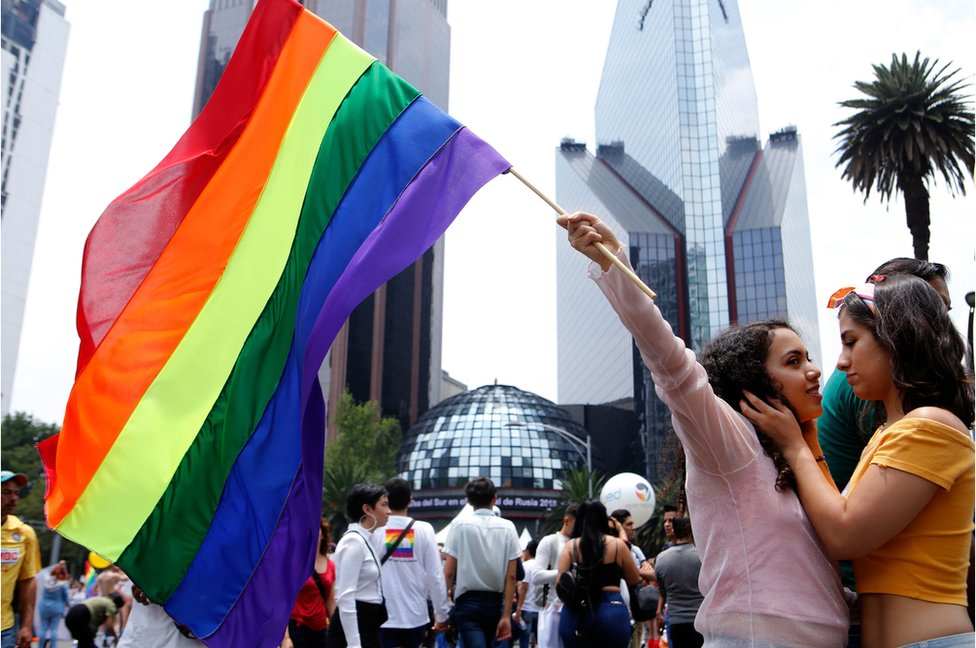 People take part in the annual Gay Pride Parade in Mexico City, on 23 June, 2018