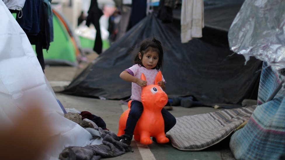 A migrant girl, part of a caravan of thousands from Central America trying to reach the United States, plays in temporary shelter in Tijuana, Mexico, November 23, 2018