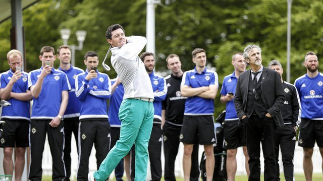 Northern Ireland players watch McIlroy in action