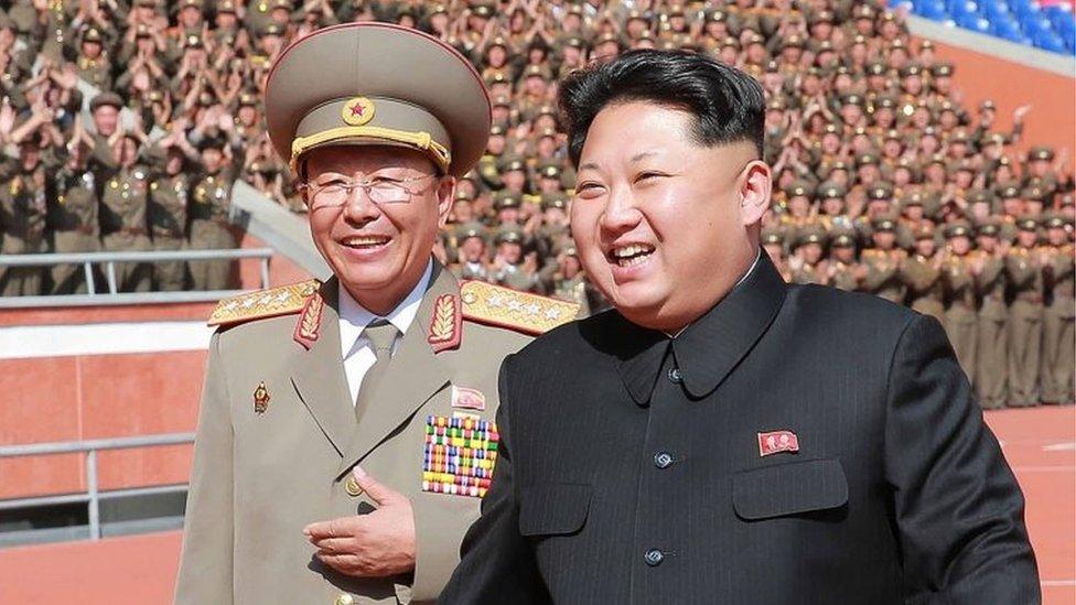 File photo of Gen Ri (left) and leader Kim Jong-un from North Korean media