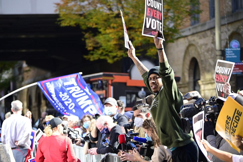 Supporters of Democratic candidate Joe Biden and Republican candidate Donald Trump face each other as hundreds gather outside the central ballot counting location at the Pennsylvania Convention Center in Philadelphia, PA on 5 November 2020 in anticipation of the results of he historic US Presidential Elections.