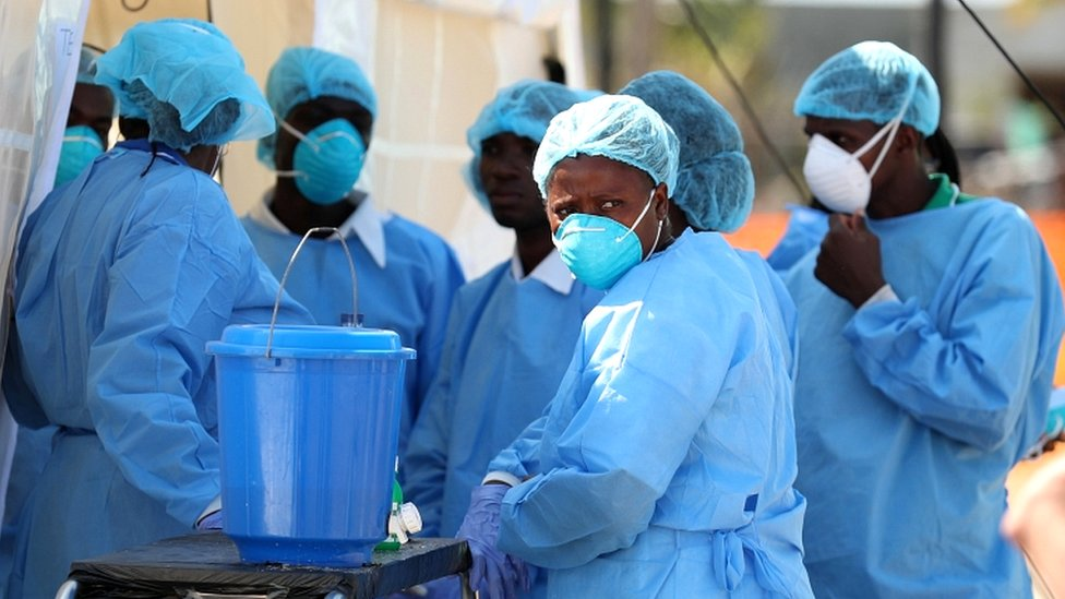 Medical staff wait to treat patients at a cholera centre set up in the aftermath of Cyclone Idai in Beira, Mozambique, March 29, 2019.