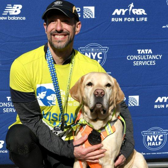 Thomas Panek after running the New York City Half Marathon with his guide dog Gus