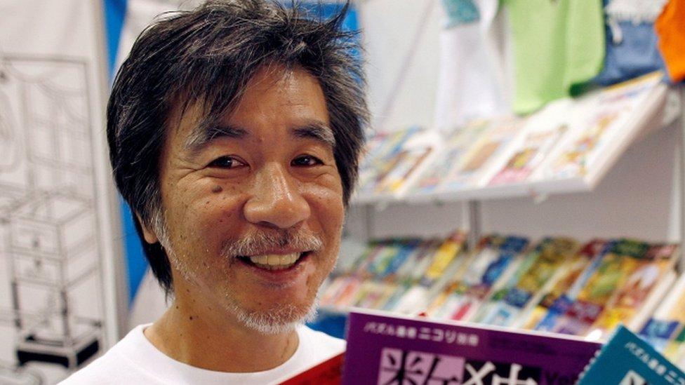 Maki Kaji holding Sudoku puzzle books in 2007