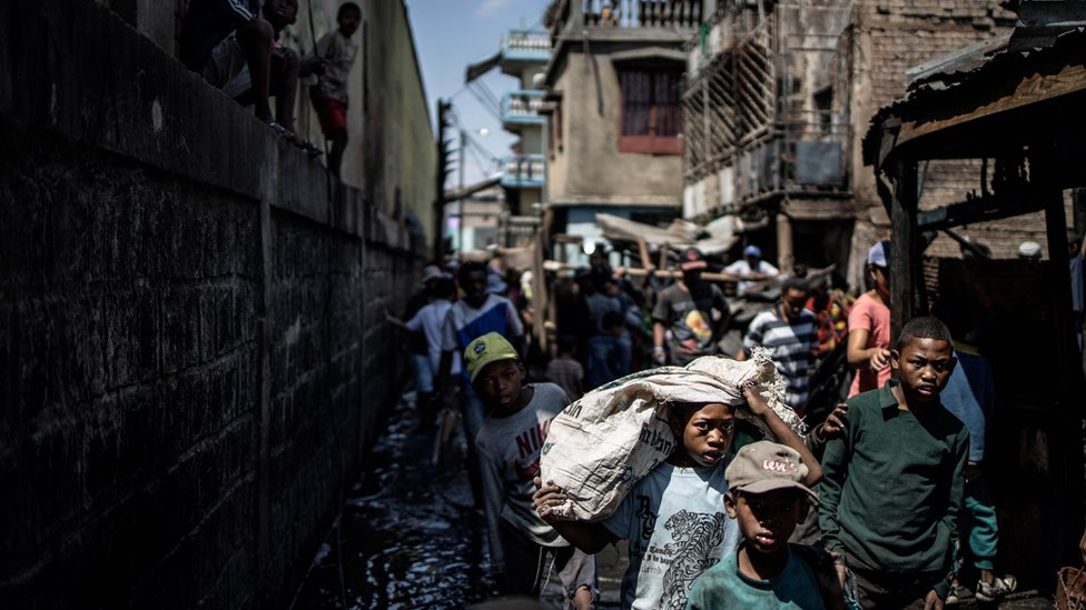 Residents trying to salvage their belonging from a fire that ravaged overnight a section of the Anosibe central market in Antananarivo.