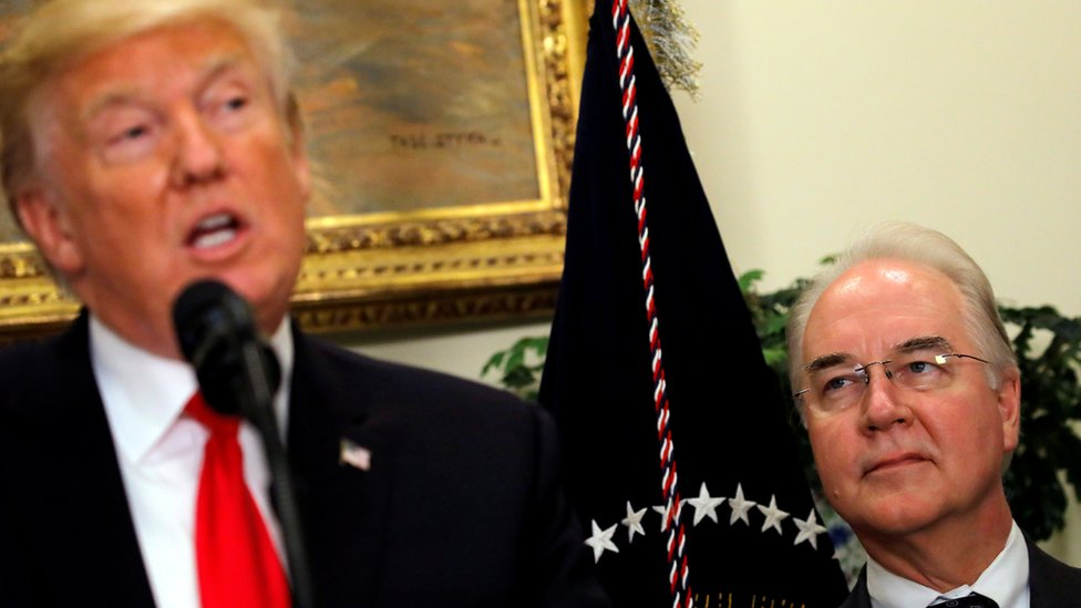 """Tom Price (R) looks at Donald Trump during a """"Made in America"""" event at the Roosevelt Room of the White House in Washington, July 20, 2017"""