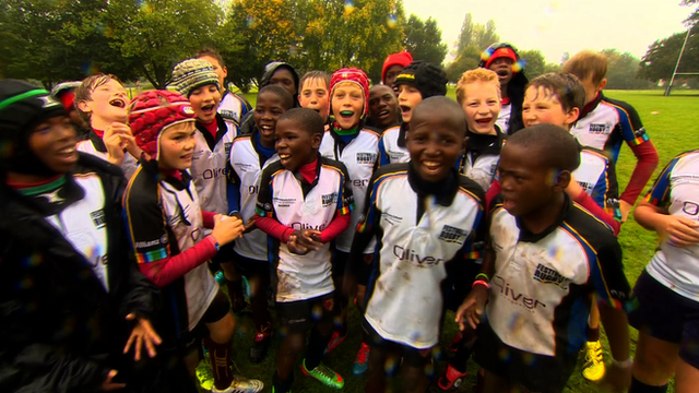 Young rugby players join together at the Tour Aid cup