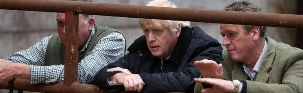 Boris Johnson with Scottish Secretary Alister Jack at a farm in Aberdeenshire