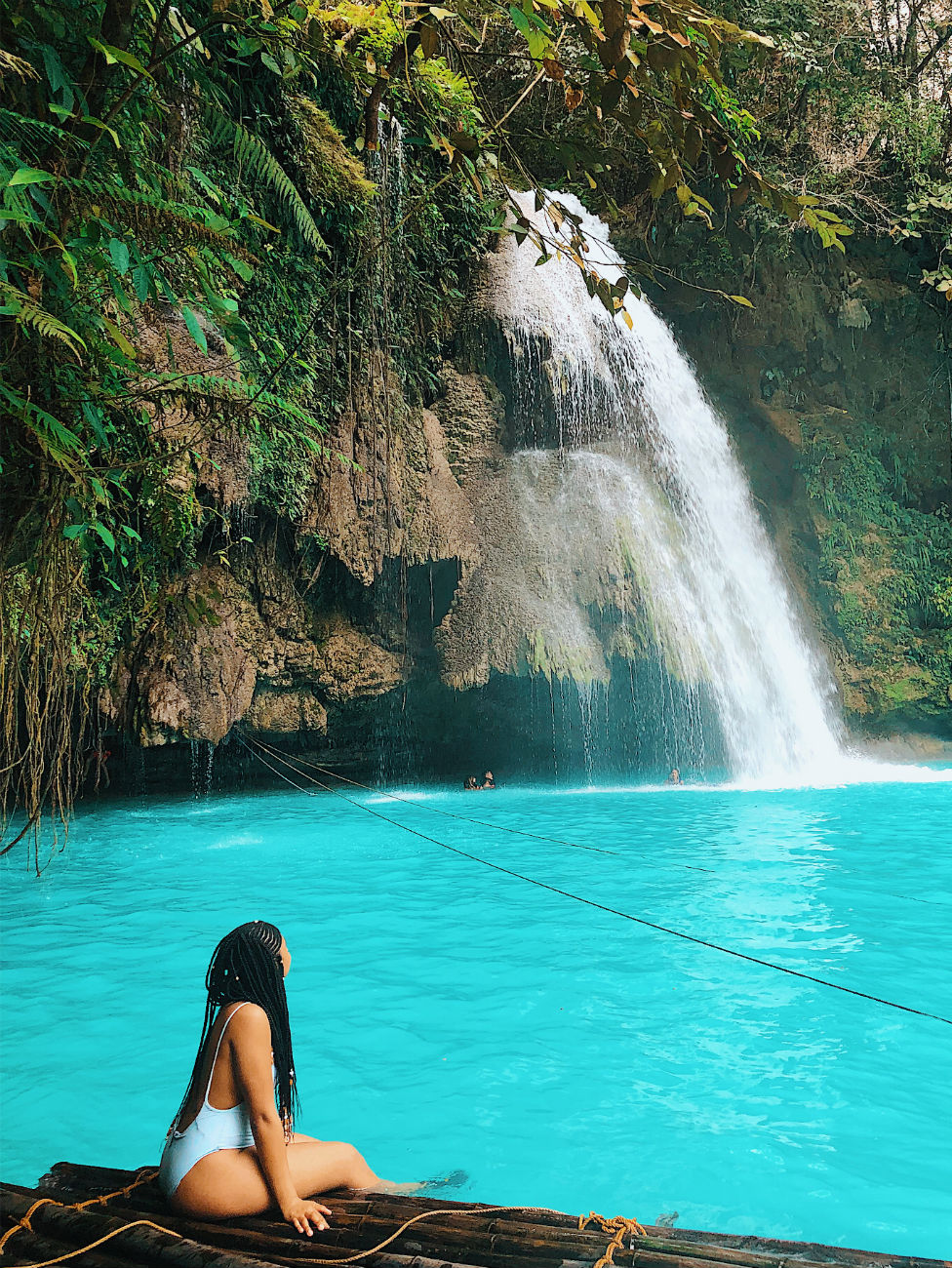 Briona Lamback sits by a waterfall in Cebu, in the Philippines.