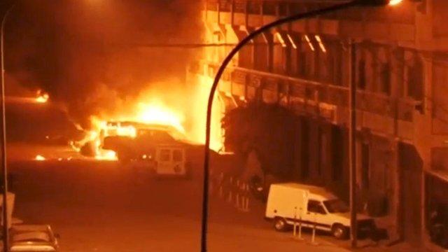 Vehicles on fire outside Splendid Hotel in Ouagadougou, during a siege by Islamist gunmen.