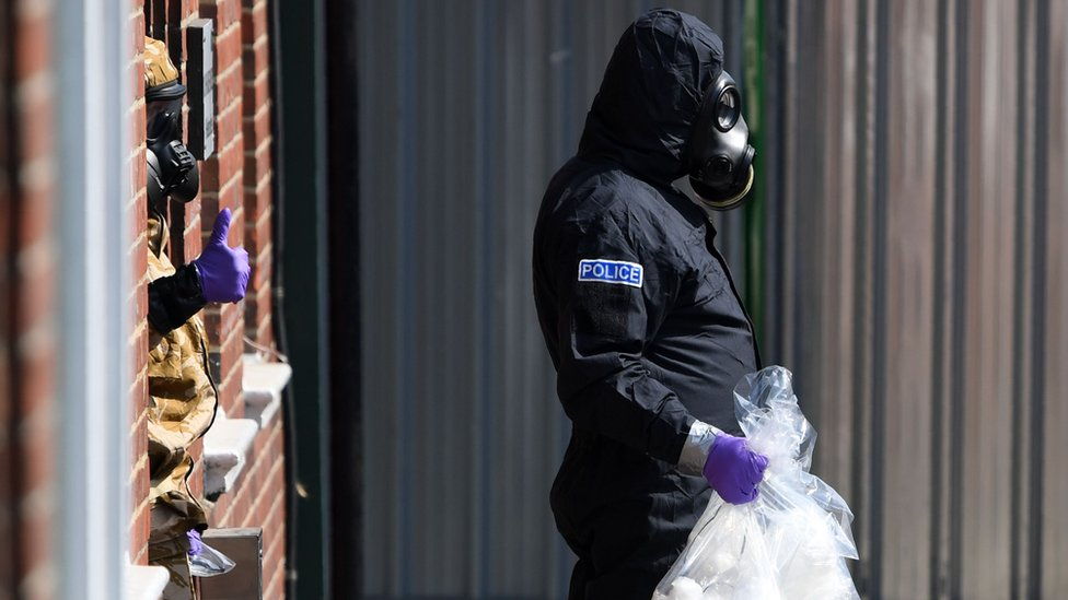 A police investigator in a protective suit in Amesbury