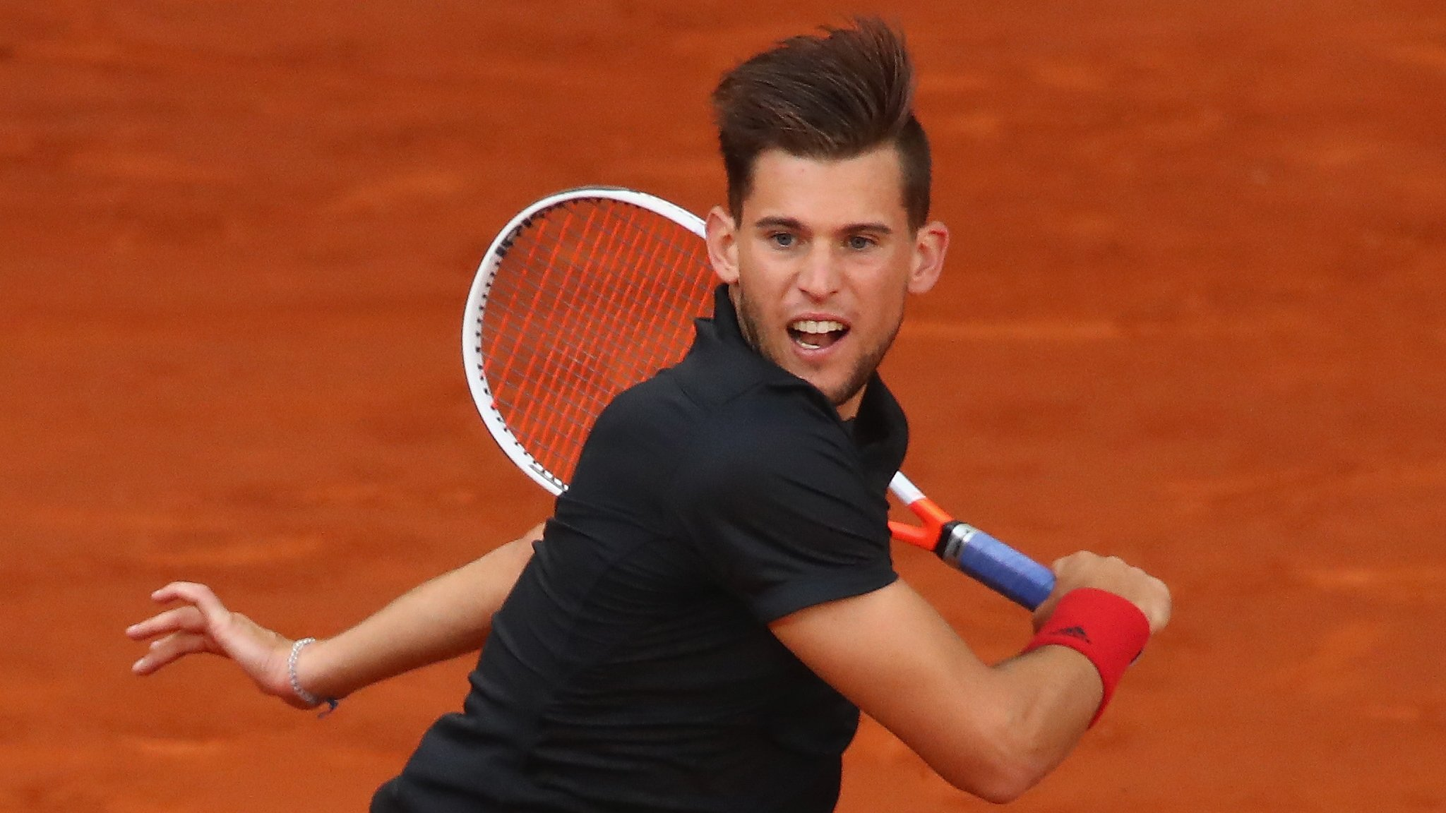 Lyon Open: Dominic Thiem takes title with victory over Gilles Simon