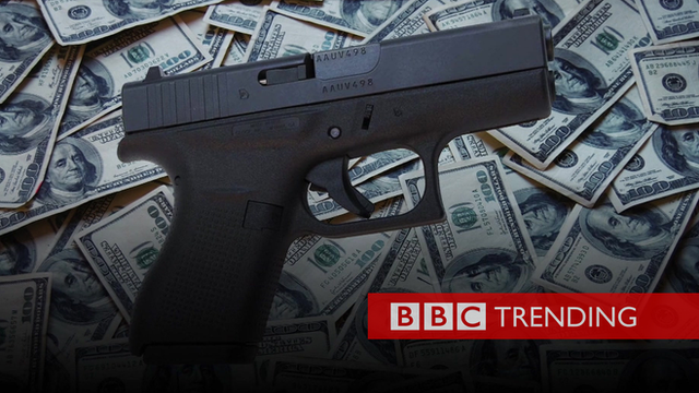 Picture of handgun with piles of dollars