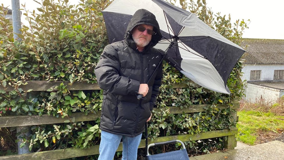 Andy Small with umbrella