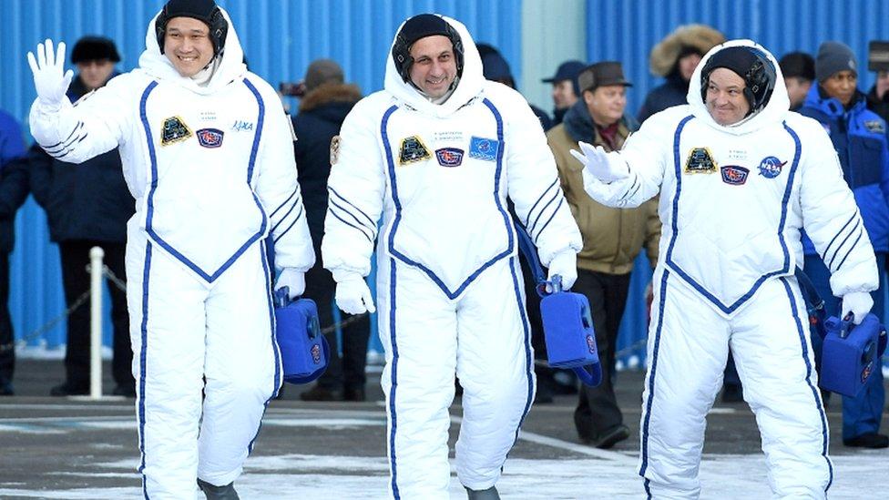 Members of the International Space Station expedition 54/55, Norishige Kanai (L) of the Japan Aerospace Exploration Agency (JAXA), Roscosmos cosmonaut Anton Shkaplerov (C), and Nasa astronaut Scott Tingle (R) before the launch of the Soyuz MS-07 spacecraft at the Baikonur cosmodrome in Kazakhstan on 17 December 2017