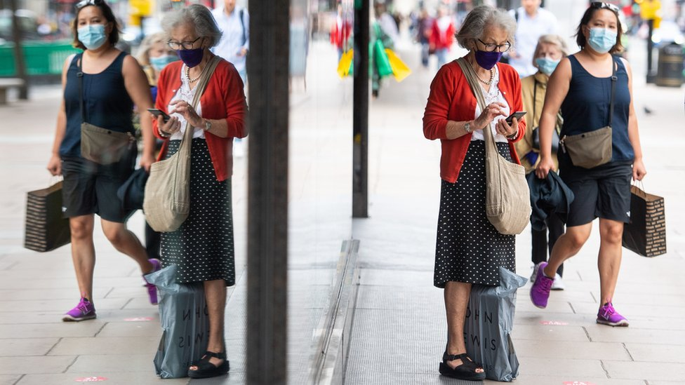 Shoppers on Oxford St wearing face masks