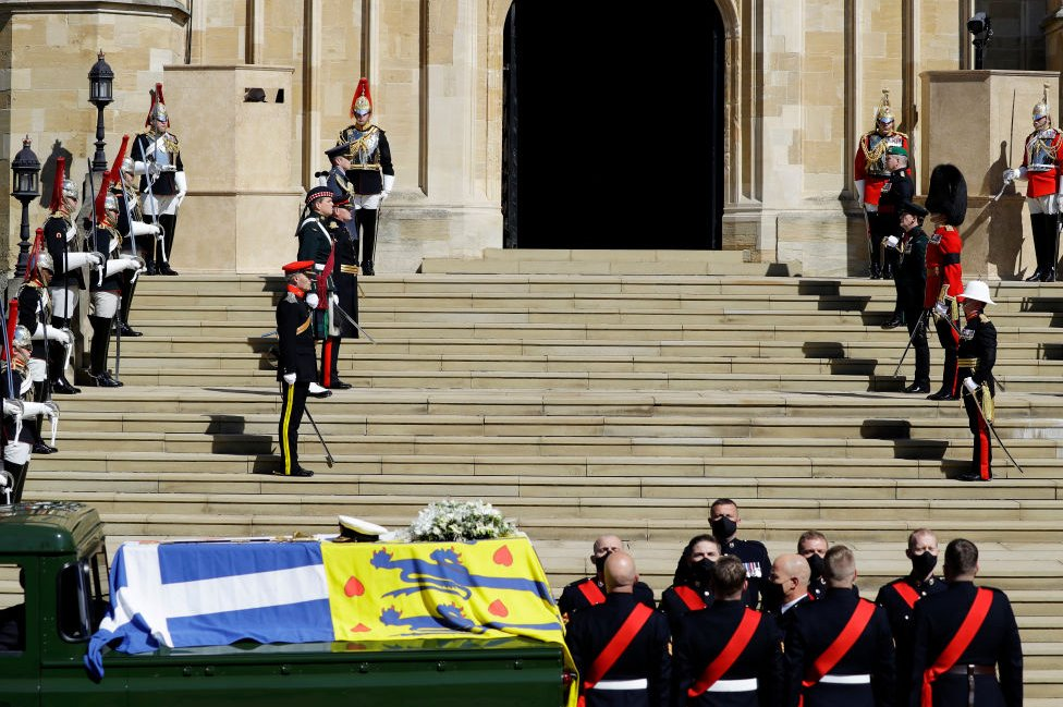 The Duke of Edinburgh's coffin, covered with His Royal Highness's Personal Standard arrives at St George's Chapel during the funeral of Prince Philip, Duke of Edinburgh at Windsor Castle on April 17, 2021 in Windsor, England.