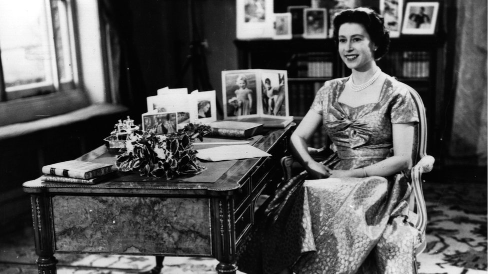 Queen Elizabeth II smiling just before the end of her first Christmas Day television speech to the nation in 1957