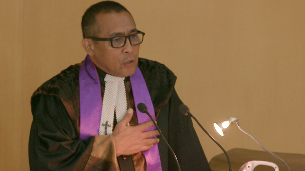 Jacky Manuputty pictured preaching at a church pulpit