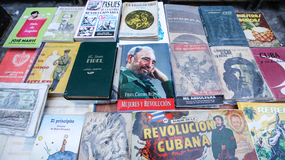 A view of a street stand with Fidel Castro, Raul Castro, Che Guevara and Cuba related books, souvenirs and memorabilia for sale, in Havana's city centre