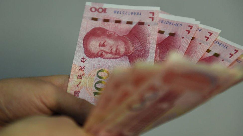 Hands holding Yuan