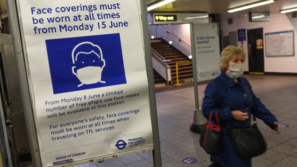 Face covering board in London Underground