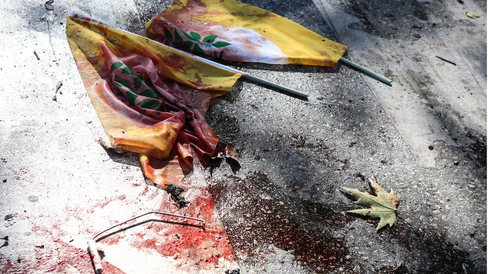 Blood covered flags at the scene of the blast after explosions in Ankara, Turkey - Saturday 10 October 2015