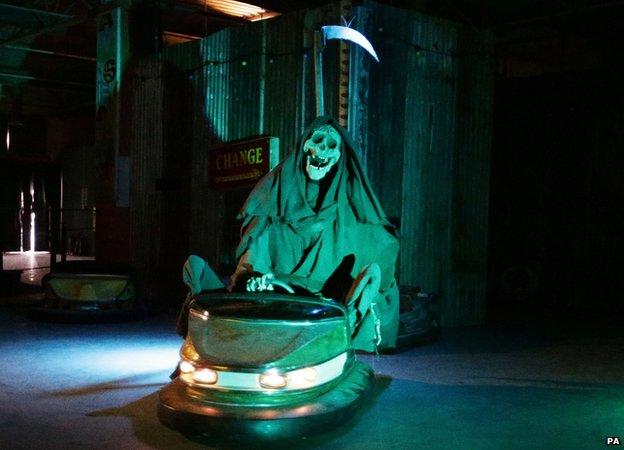 The Grim Reaper riding a dodgem