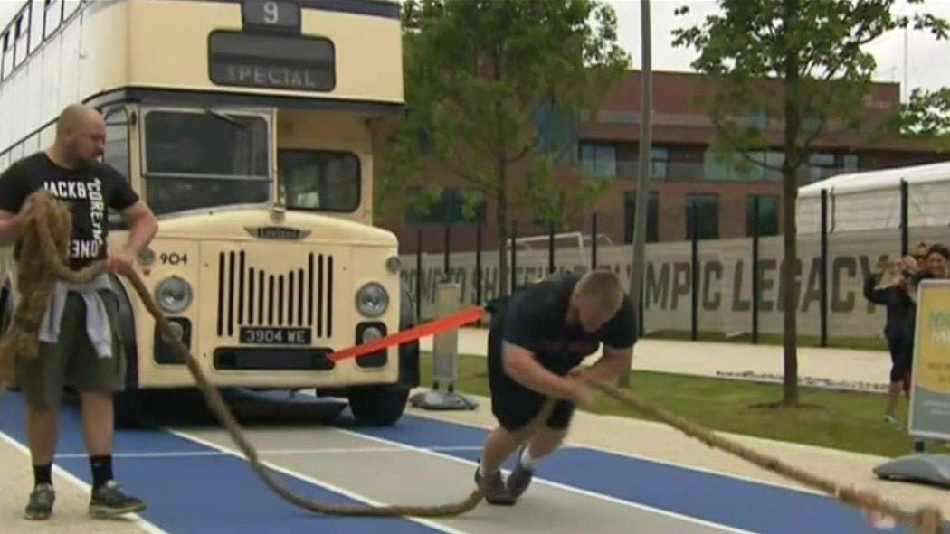 World Champion strongman Paul Smith pulls double decker bus