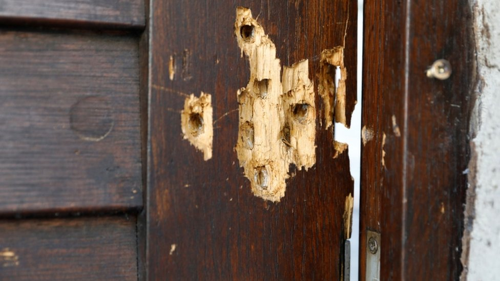 Bullet holes are seen in the door of a synagogue in Halle, Germany, July 28, 2020