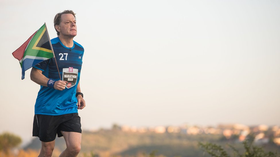 "Comic Relief handout file photo of Eddie Izzard during marathon number ten of 27 in his gruelling Sport Relief challenge. The finish line is in sight as he prepares to reach Robben Island on the final leg of his challenge, that pays tribute to Nelson Mandela""s life."