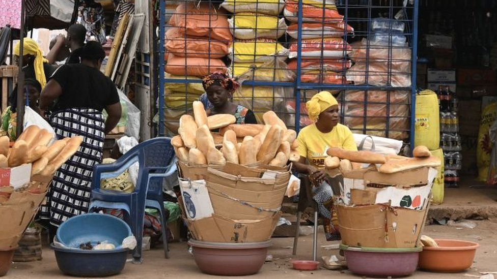Vendors sell bread in Duekué, western Ivory Coast, 9 October 2020