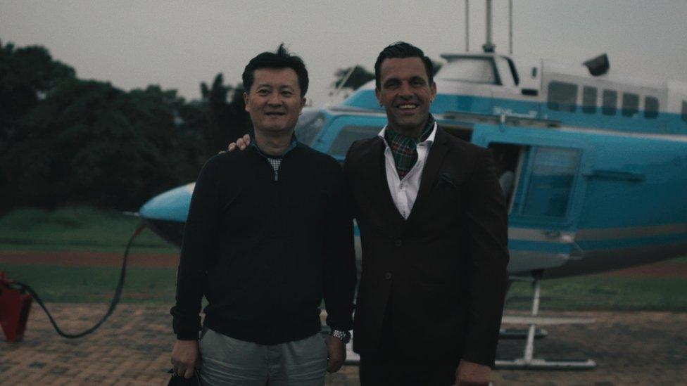 'Mr Danny' (left) and 'Jim Latrache-Qvortrup' posing in Uganda