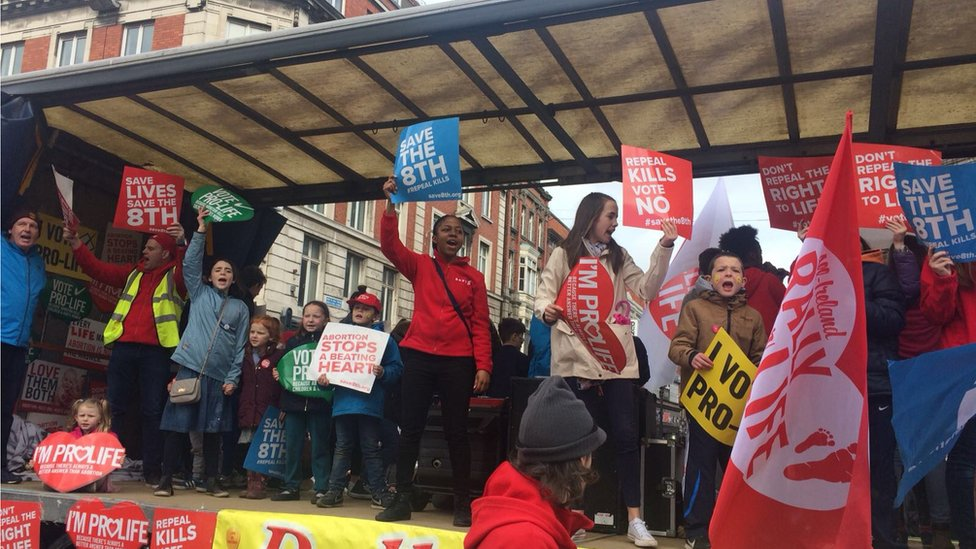 PRO-LIFE CAMPAIGNERS WAVE PLACARDS