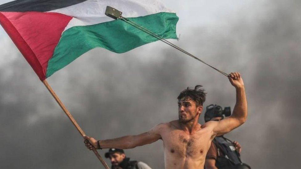 فلسطينيون أثناء مظاهرة