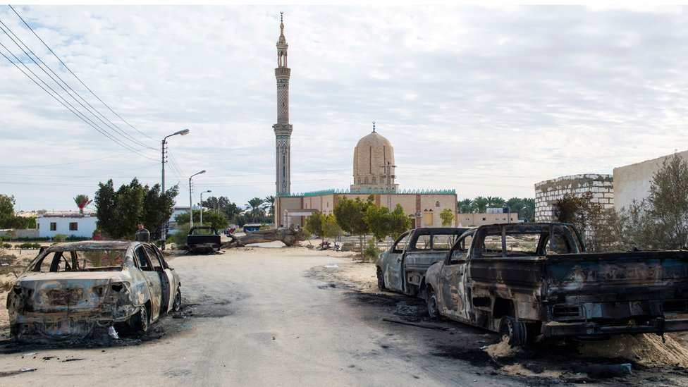 Burnt-out cars in the aftermath of the attack on Rawda mosque, 25 November 2017