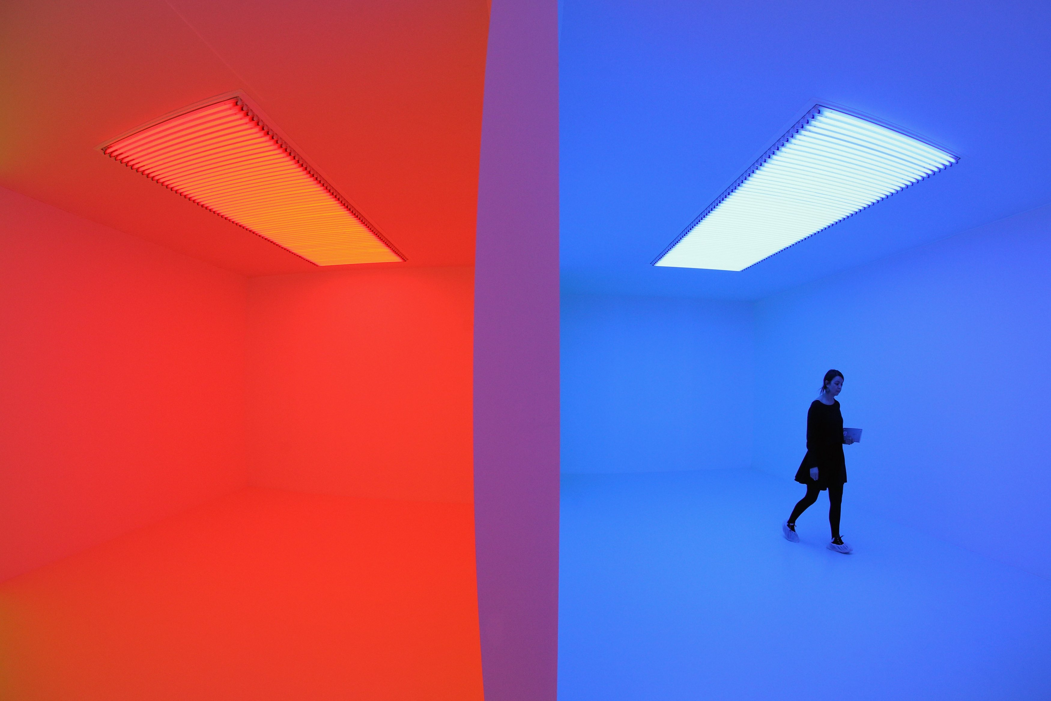 A woman admires an art installation by Carlos Cruz-Diez entitled 'Chromosaturation' which features in the Hayward Gallery's exhibition 'Light Show' on January 29, 2013 in London, England.