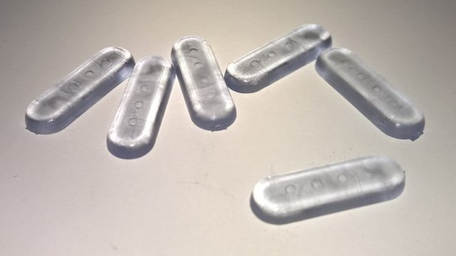 plastic pills with four barcode indentations