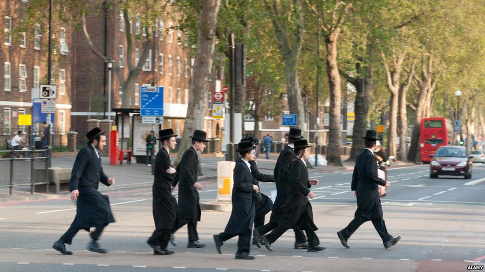 Ultra-Orthodox men walking across a road in London
