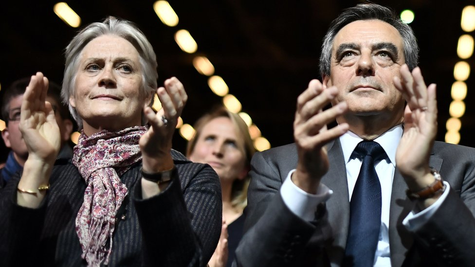 French presidential candidate Francois Fillon (right) and his wife Penelope attend a campaign rally in Paris, 25 November 2016