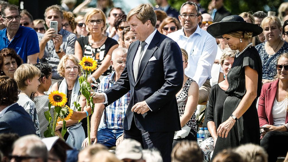 King Willem-Alexander and Queen Maxima joined families in laying sunflowers at the memorial