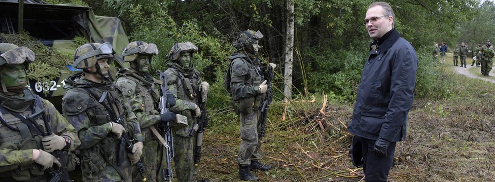 Finland's Defence Minister Jussi Niinisto inspects Finnish troops during a co-operation of the Finnish and Swedish troops on the Swedish island of Gotland September 19, 2017