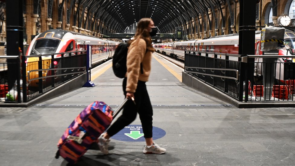 A commuter at Kings Cross train station in London