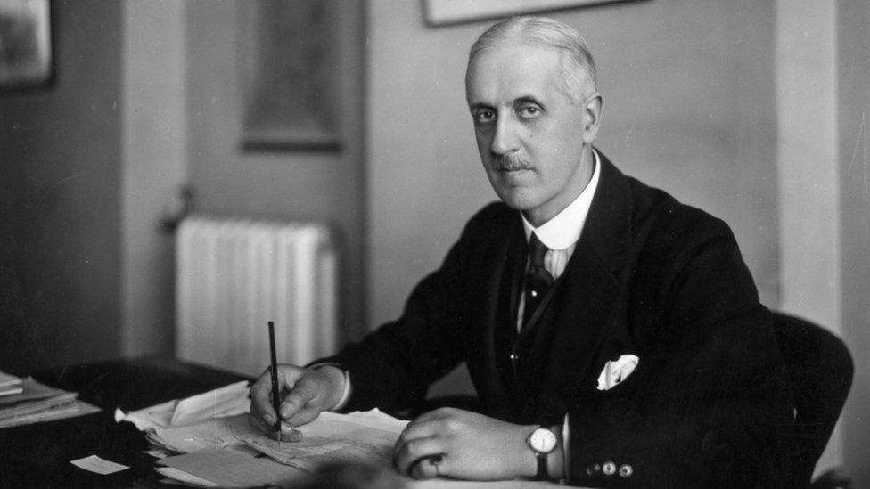 Sir Fabian Ware sitting at his desk