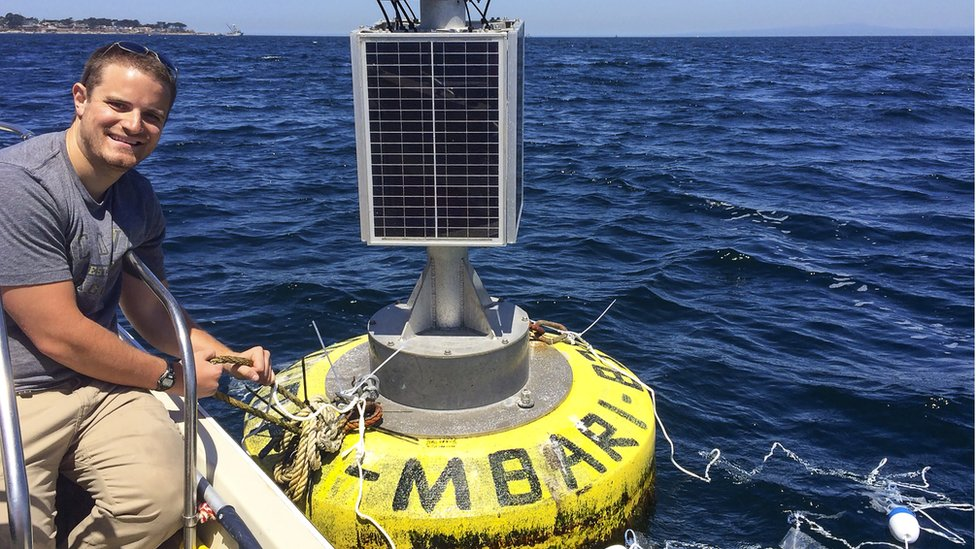 Deploying experimental plastic debris at a buoy in Monterey Bay, California