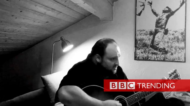 screen shot from a video showing musician Alex Diehl playing his song